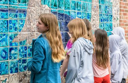 Children view the Mosaic mural